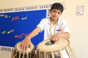 Student playing tabela music