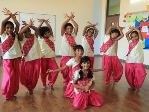 Girls Students dancing - Pink Color Kurti and White Top
